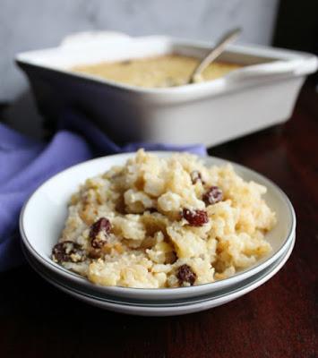 bowl of rice pudding with cinnamon and raisins