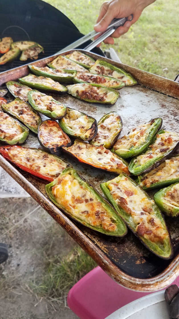 taking stuffed jalapenos off the grill