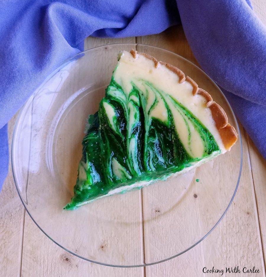 Slice of creamy kiwi pie on plate ready to eat.
