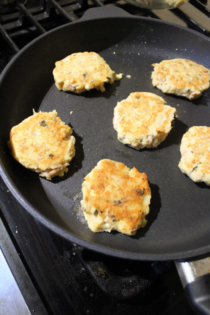 skillet of golden salmon potato patties