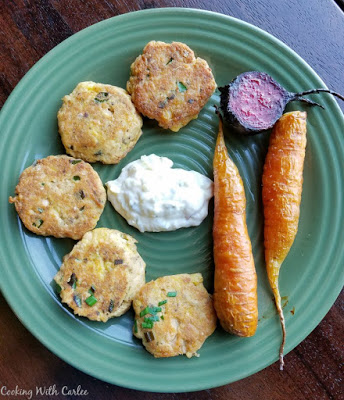 salmon patties, carrots and beets on plate