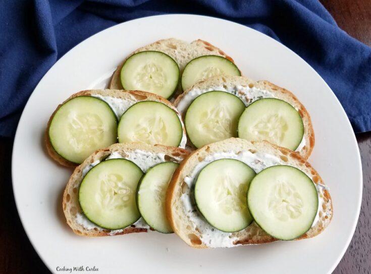 plate of ranch cucumber bread appetizers on Italian bread.