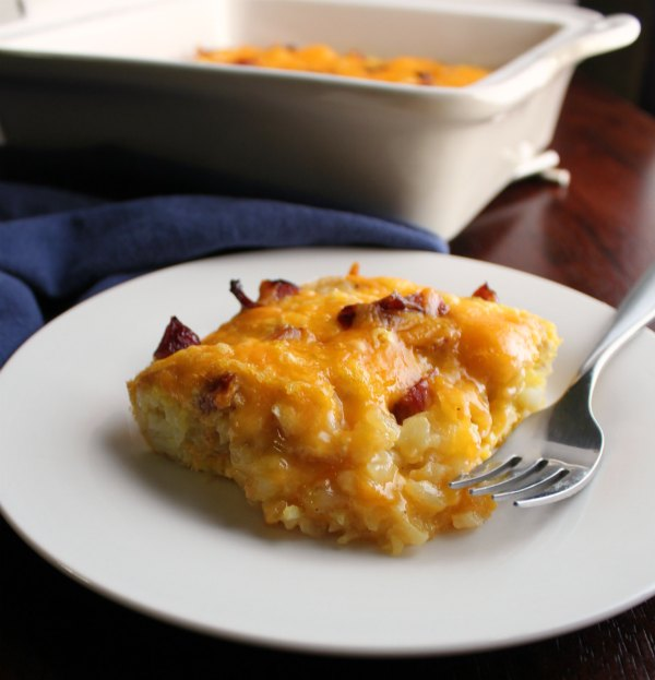 piece of ham and cheese tater tot breakfast casserole ready to eat.