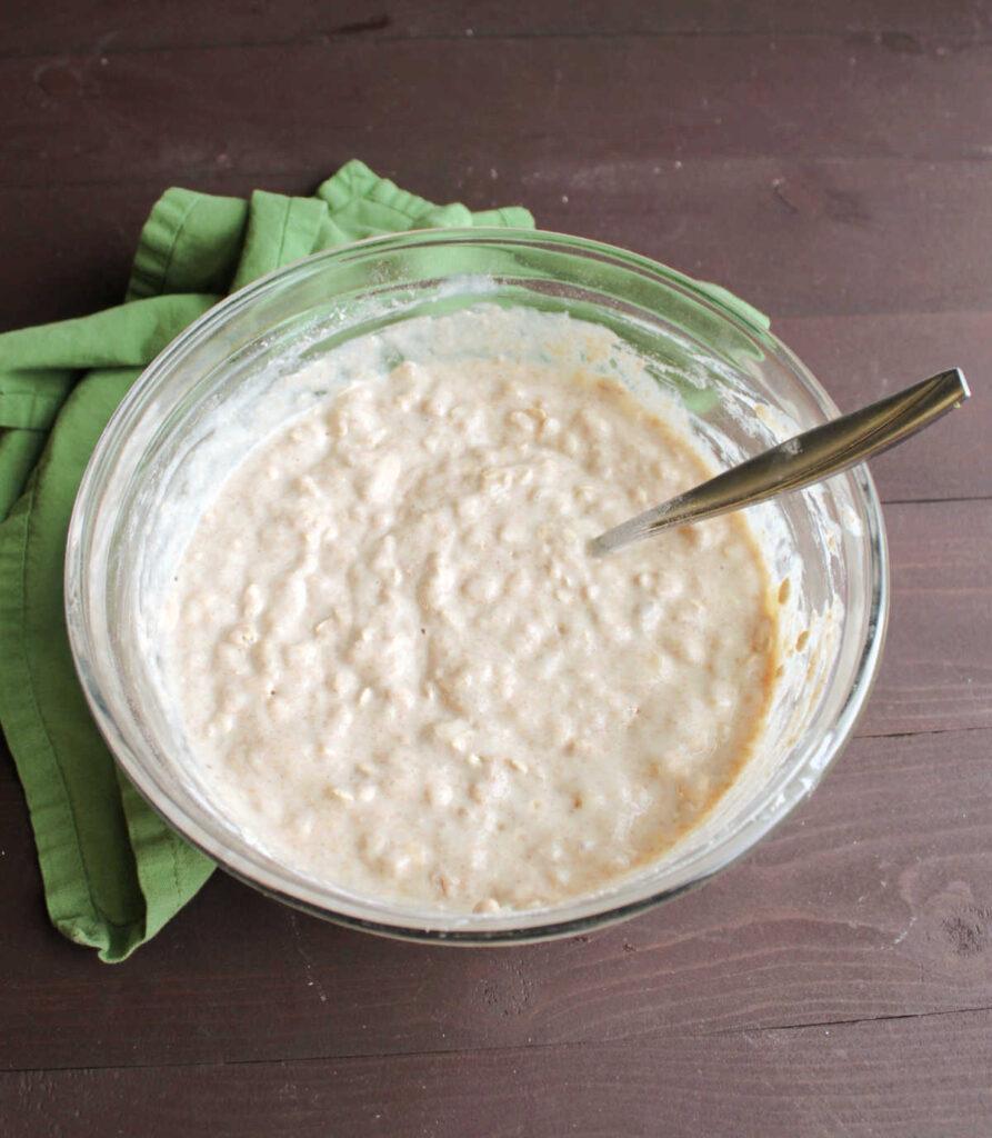 Bowl of pancake batter with whole wheat, oatmeal, yogurt and bananas.
