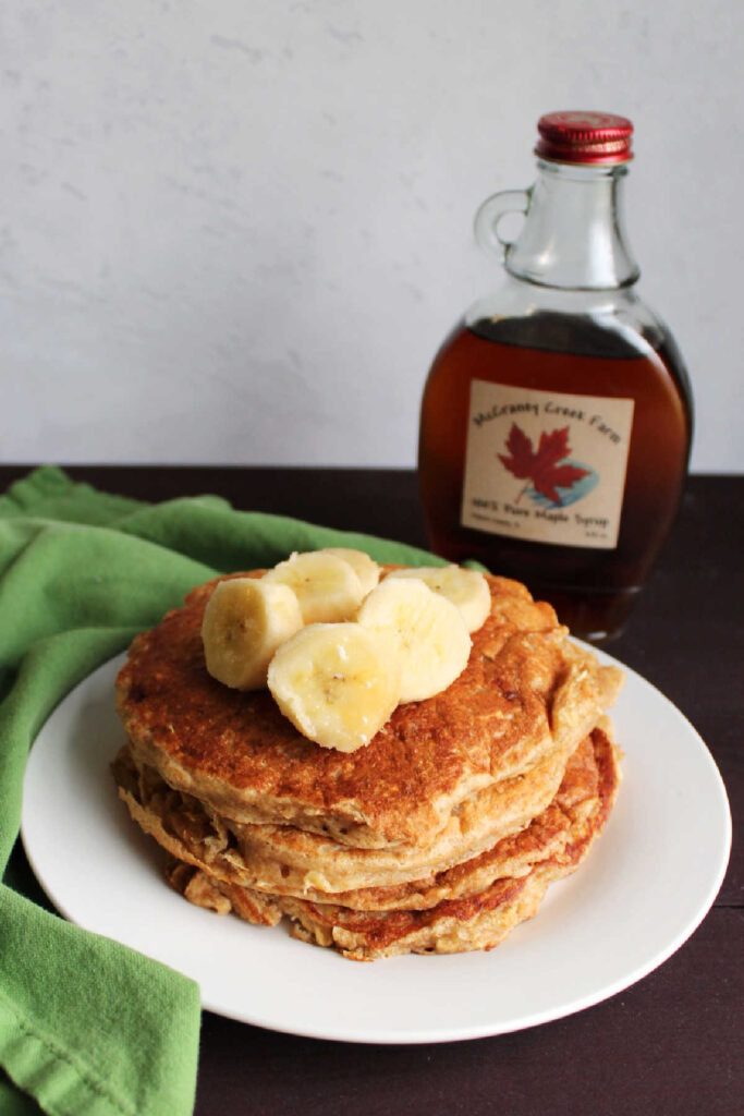 Pancakes loaded with the good stuff, whole grains, banana, yogurt and no added sugar! They are soft and flavorful and ready to be your breakfast!