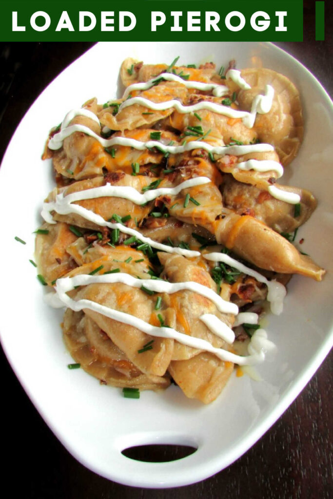 These homemade pierogi and loaded with flavor. Cheese, bacon, sour cream and chives just like a loaded baked potato but in extra yummy dumpling form.