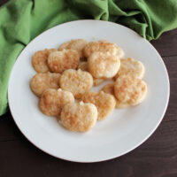 Small cookies made from pie crust scraps in the shape of apples and coated in butter, cinnamon and sugar.