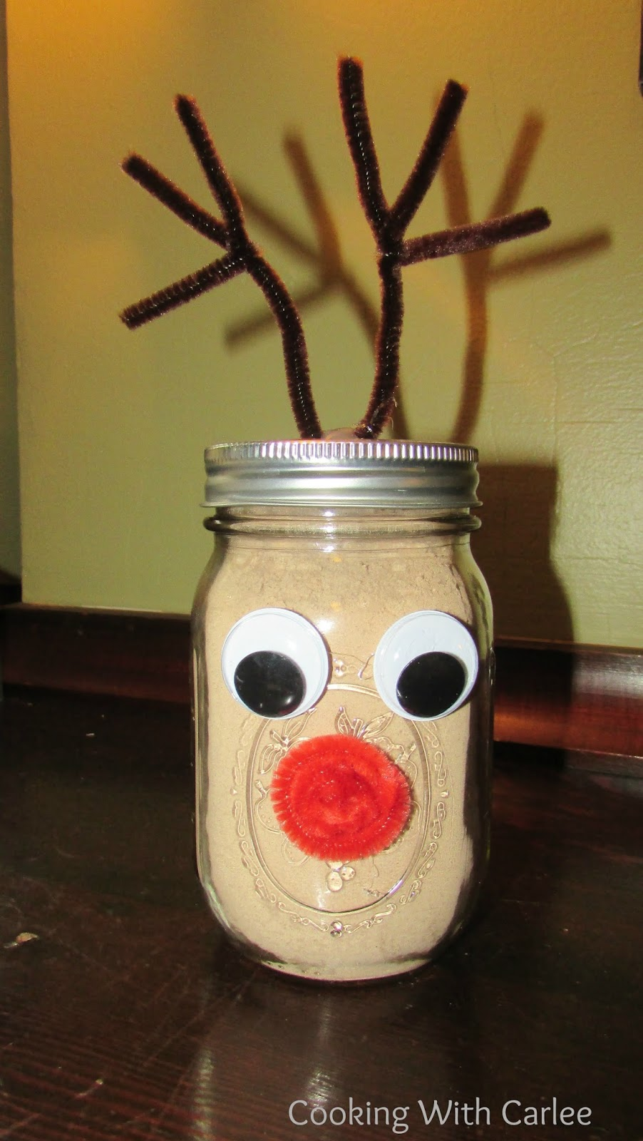 Jar of hot chocolate mix decorated to look like rudolph the red nosed reindeer.