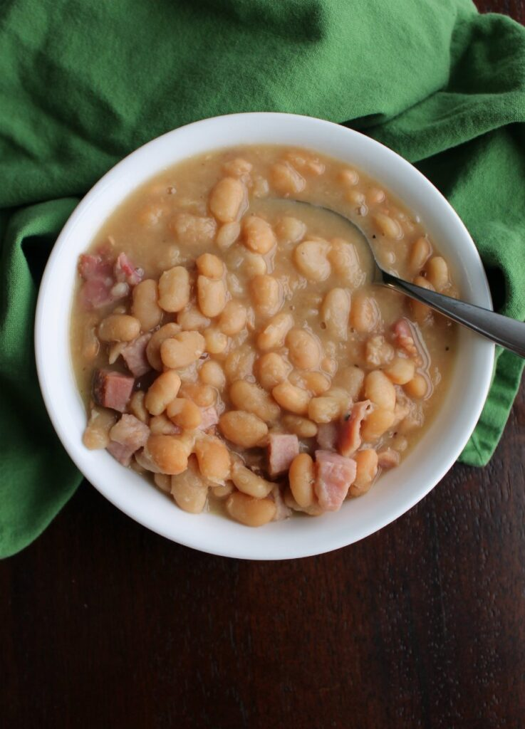 bowl filled with thick ham and beans ready to eat.