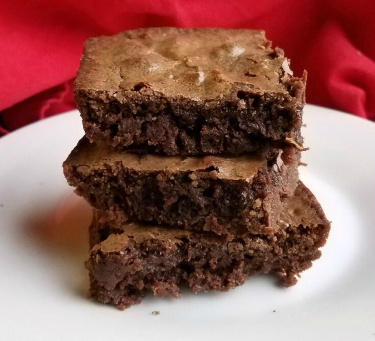 stack of fudgy brownies with crackly tops.