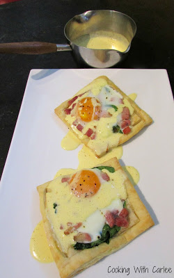 eggs benedict tarts with homemade hollandaise drizzled over the top.