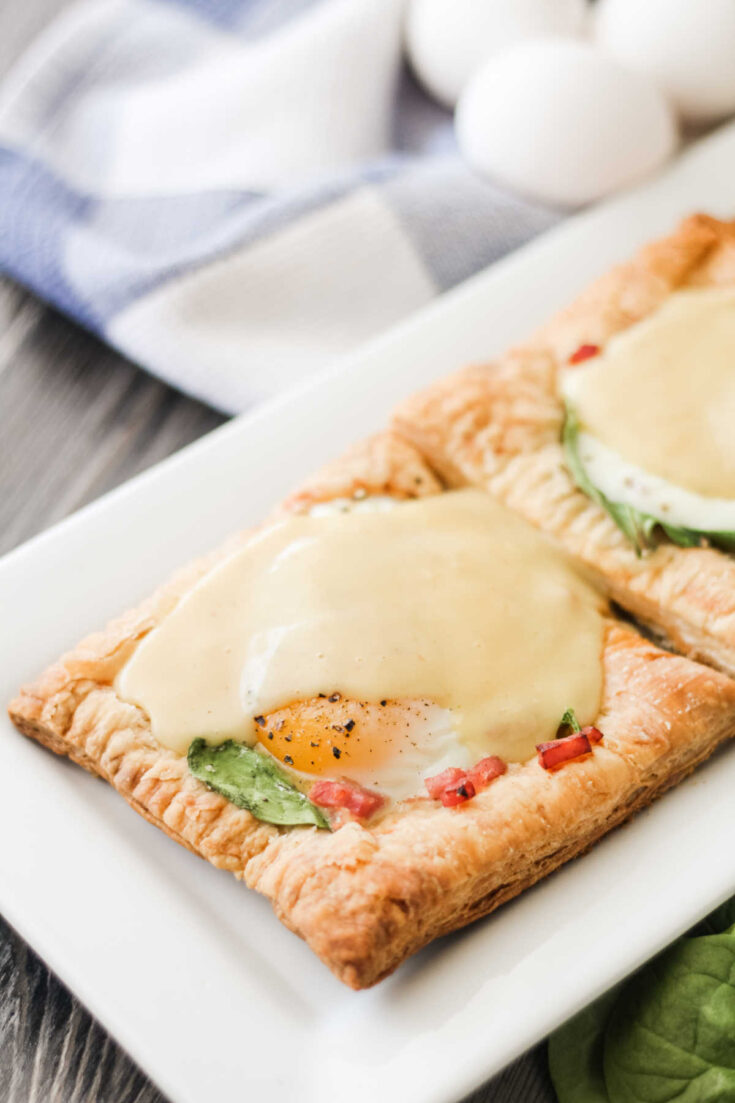 Puff pastry topped with ham, spinach, egg and hollandaise sauce.