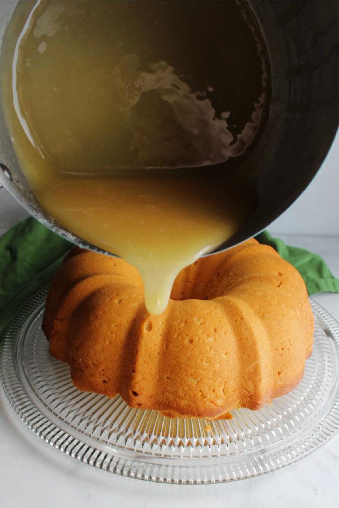 Pouring caramelized honey glaze over bundt cake.