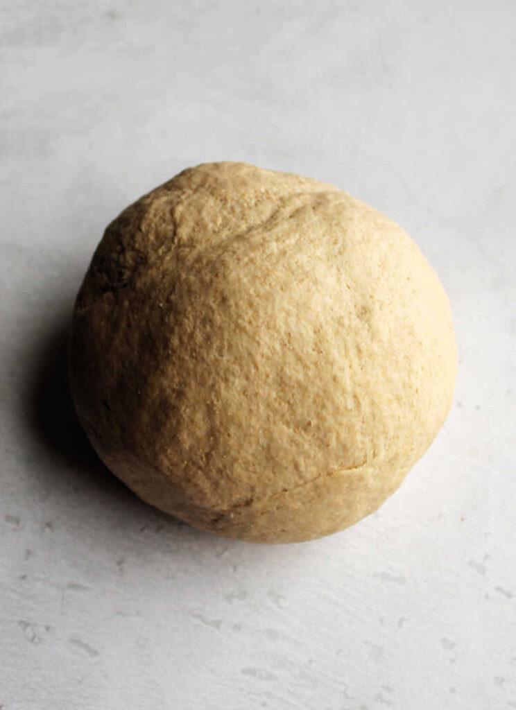 ball of freshly kneaded sourdough sandwich bread dough