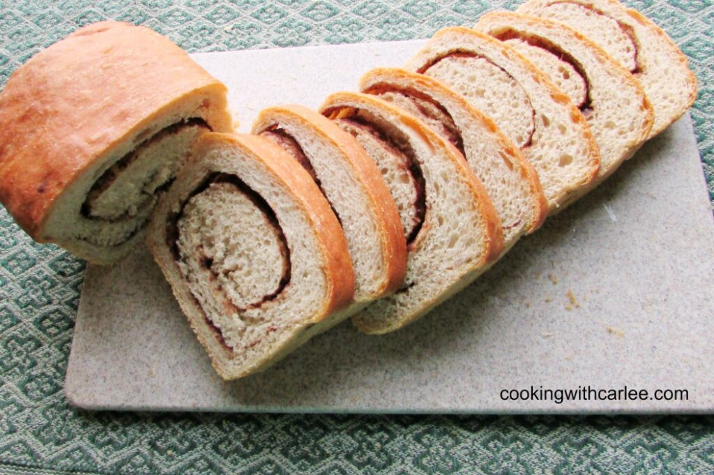 slices of cinnamon swirl bread next to remainder of loaf.