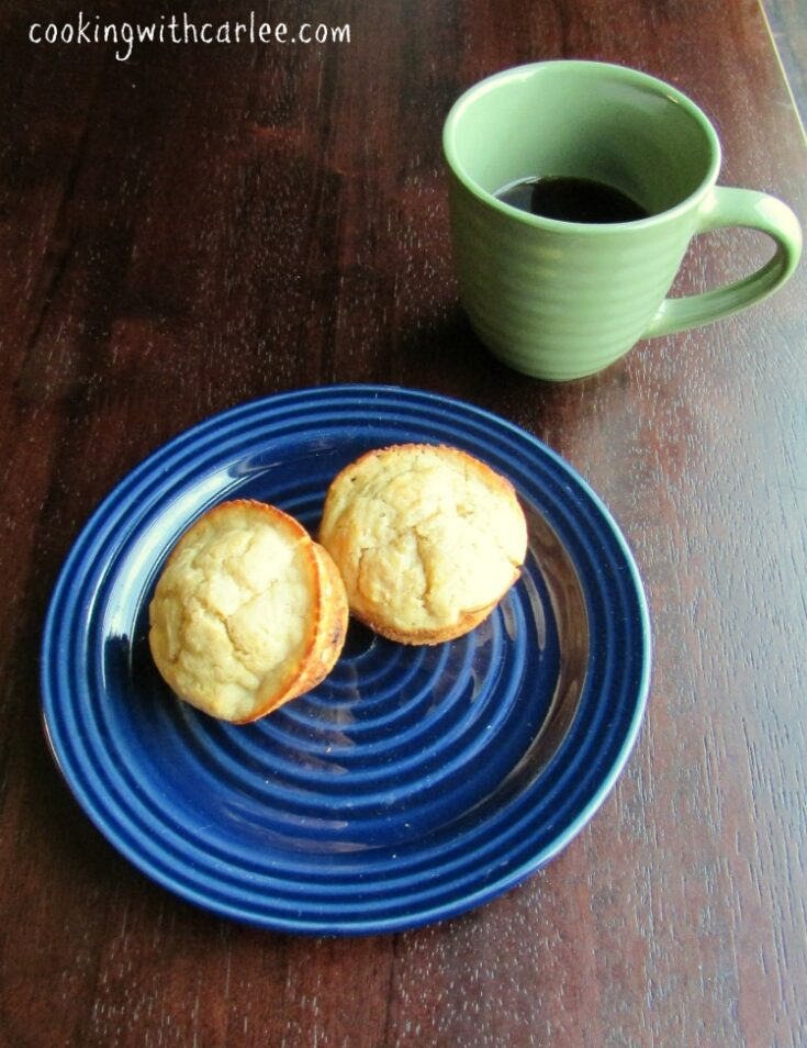 Sourdough banana muffins next to cup of coffee.