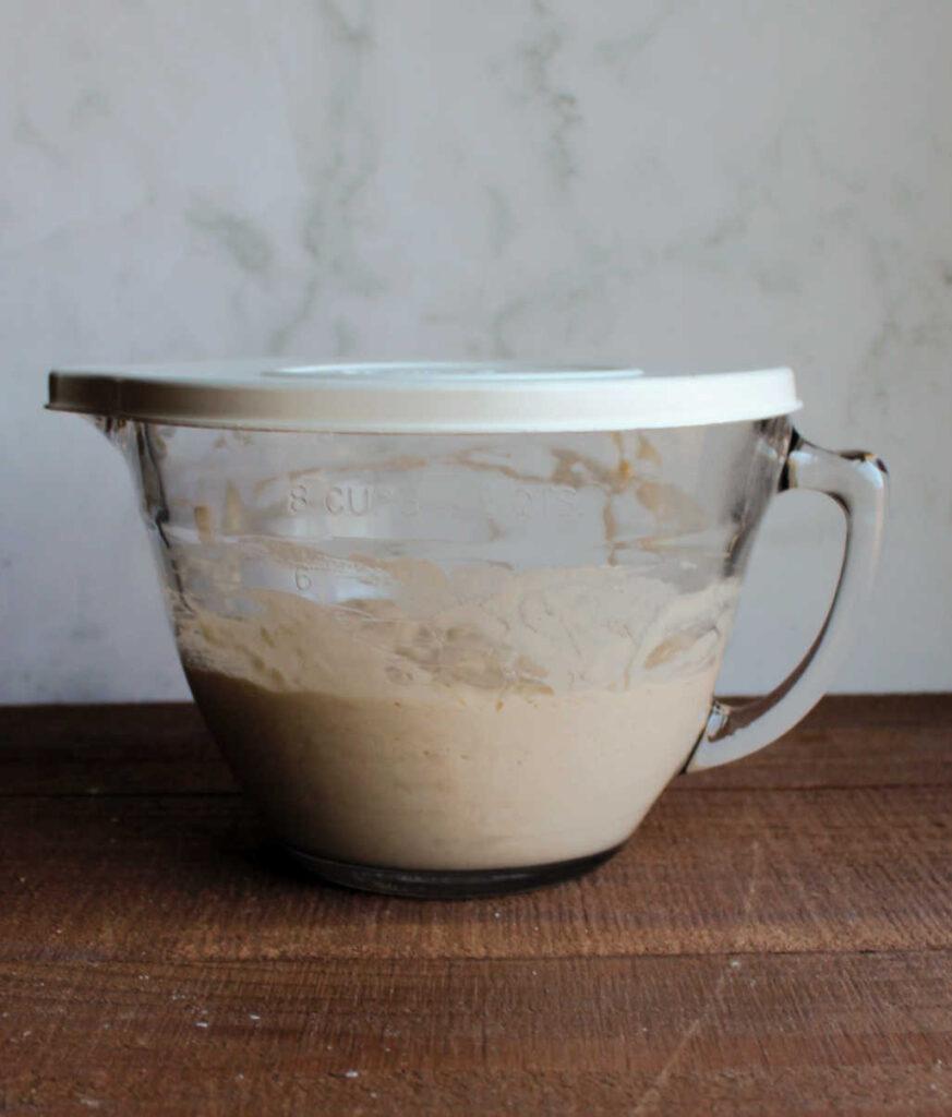 glass bowl full of sourdough sponge for waffles