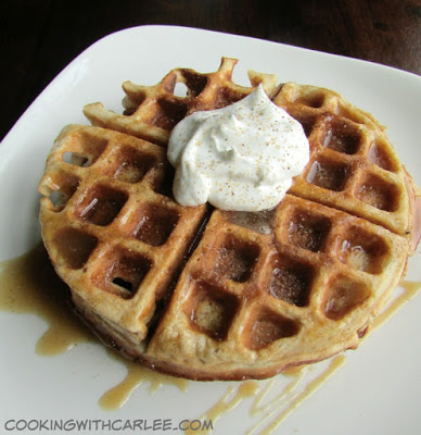 apple cider waffle drizzled with cider caramel and topped with a dollop of whipped cream.