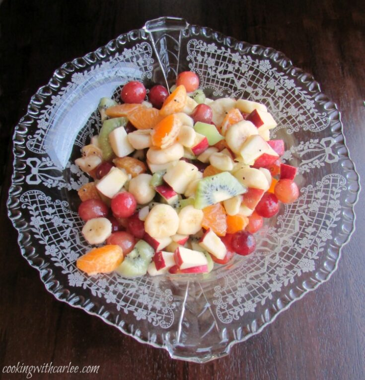 bowl of fruit salad with kiwi, bananas, grapes, apples and more.