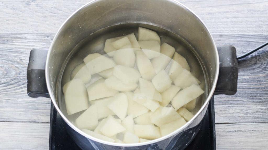 pan of potatoes boiling for potato dough.