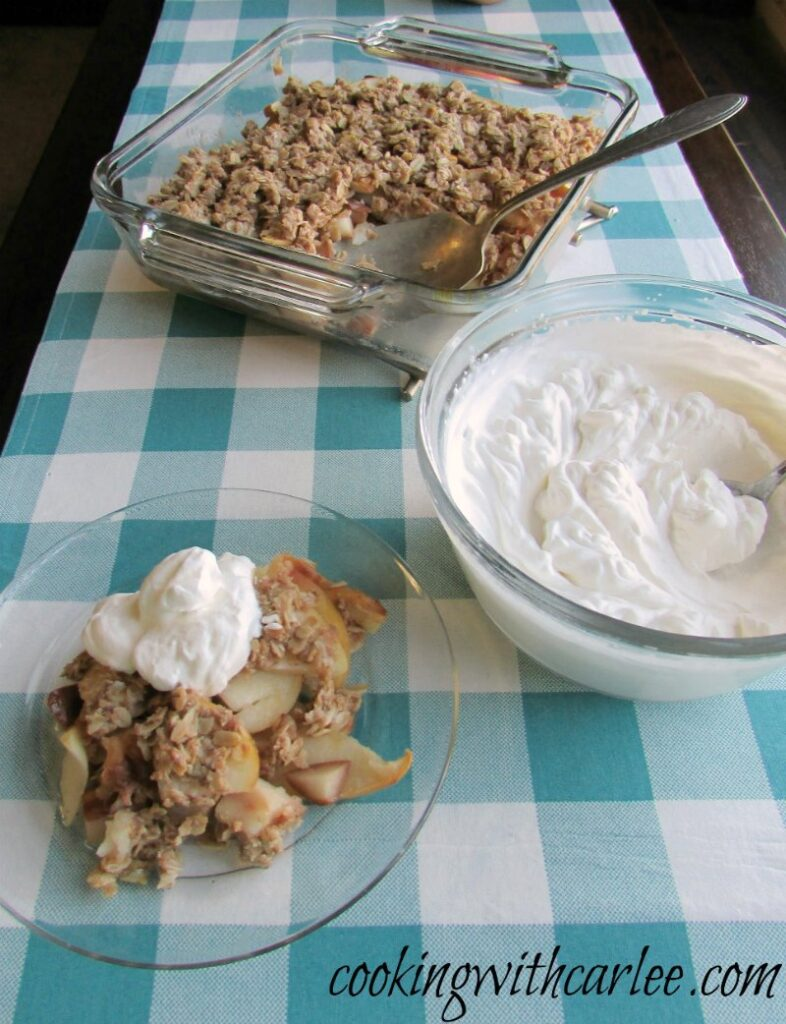 apple crisp with fresh whipped cream on top.