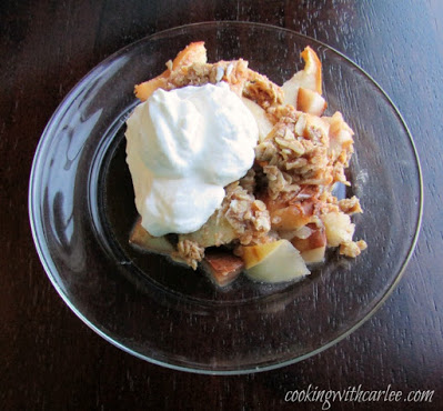 small plate of apple crisp and whipped cream
