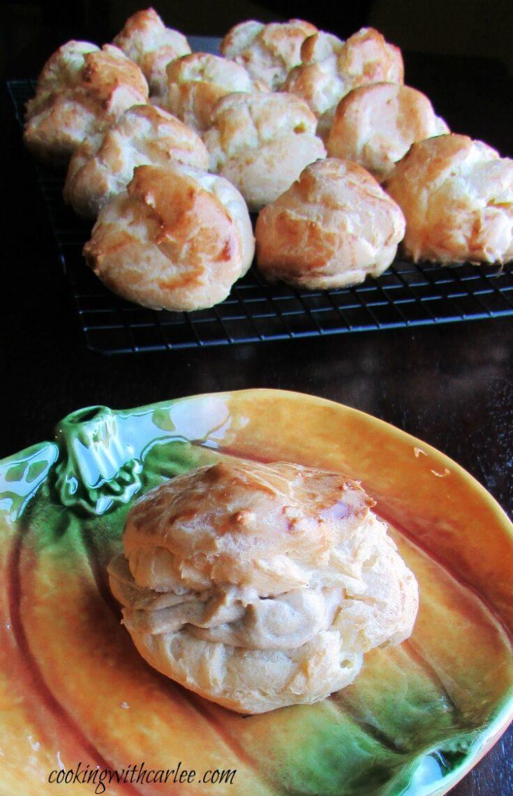 Pumpkin cream puff on pumpkin shaped plate.