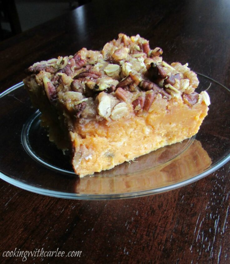 piece of maple sweet potato casserole with pecan and oat topping.