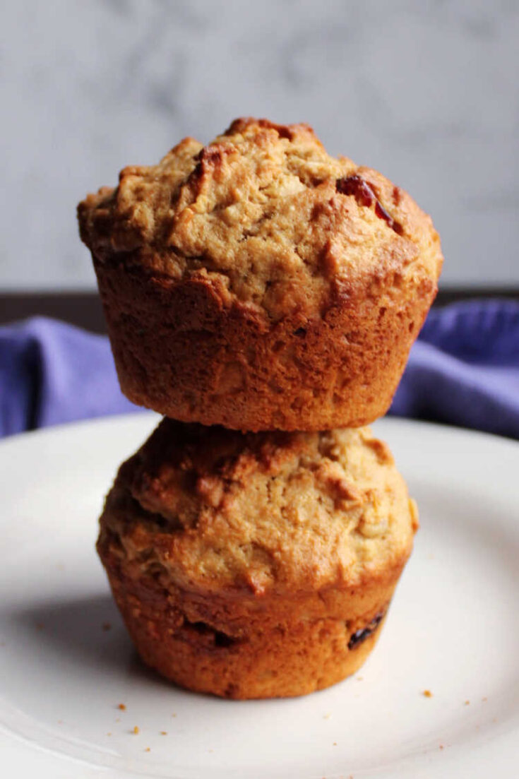 stack of cranberry sourdough muffins on plate