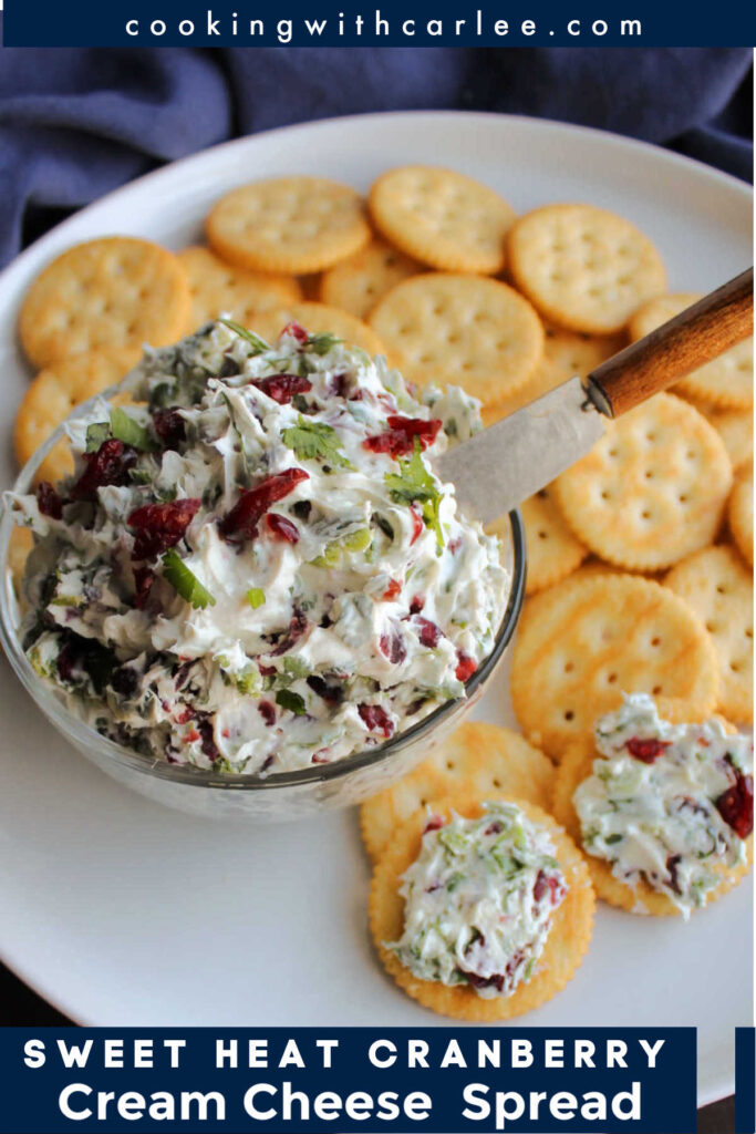 This spread is full of fresh herb flavor with a bit of spice and some sweet cranberries. The balance is delicious and it is the perfect spread for crackers.