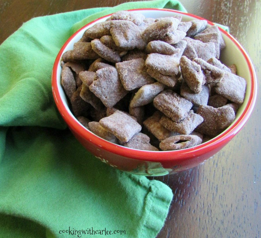 looking across a bowl of puppy chow coated in brownie batter.