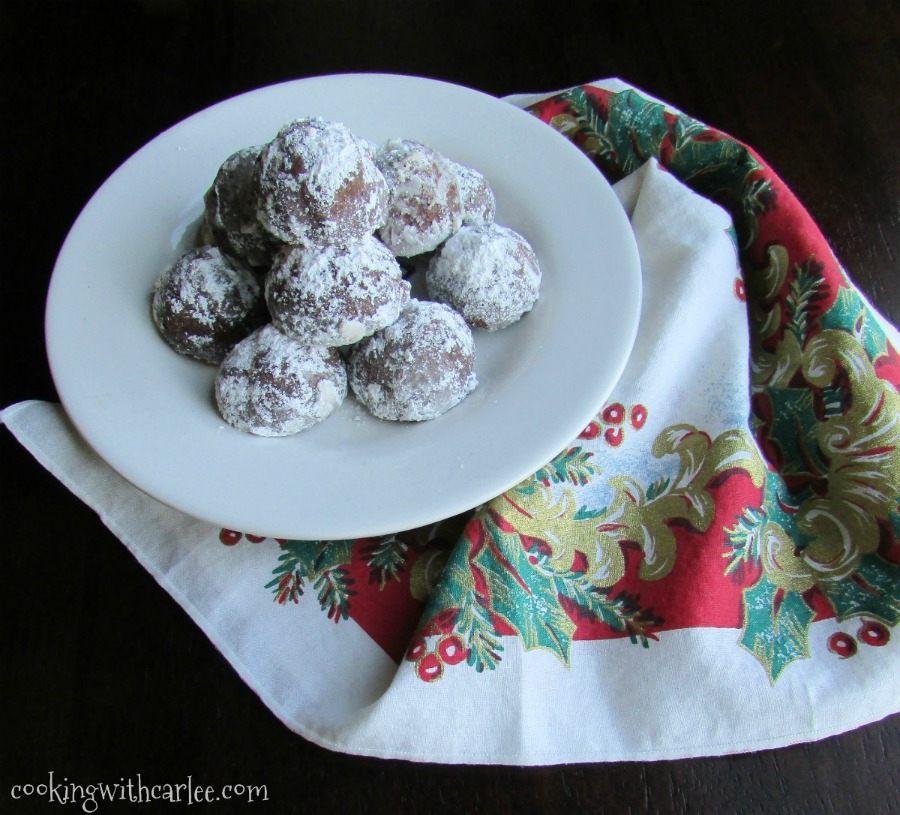 plate of chocolate covered cherry snowball cookies with Christmas napkin.