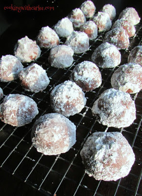 chocolate covered cherry snowball cookies on a cooling rack
