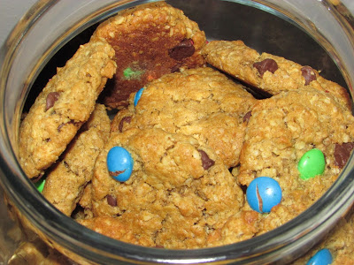 Looking into a cookie jar filled with monster cookies with m&ms.