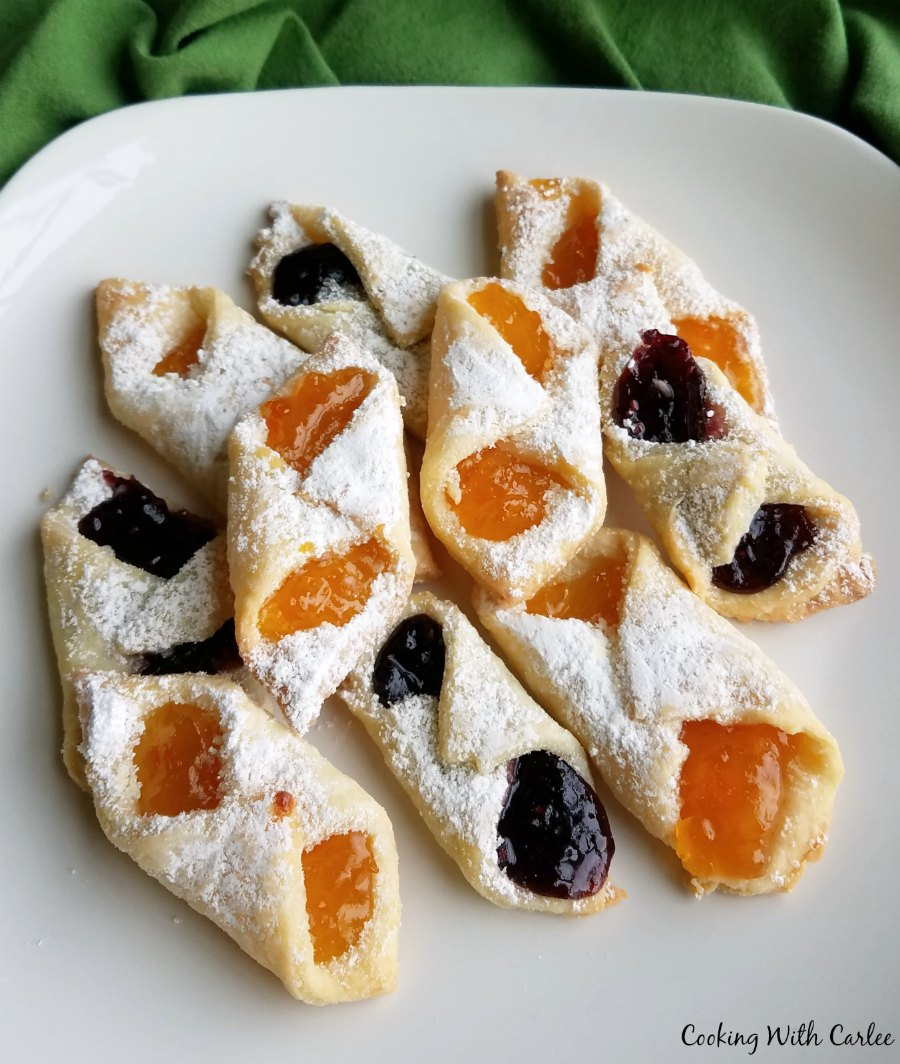 plate of kolacky, some with apricot filling and some with berry filling.