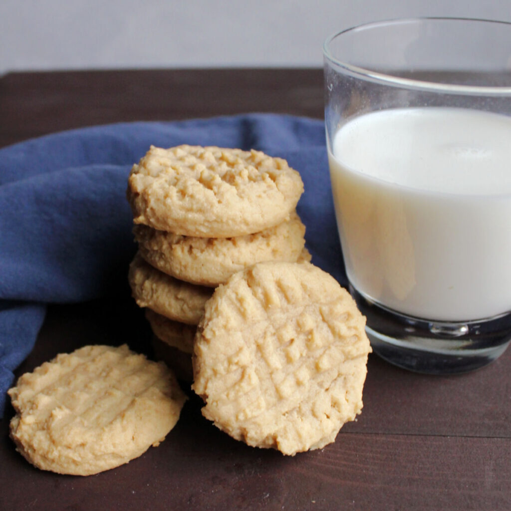 peanut butter cookies for fork hashmark next to glass of milk