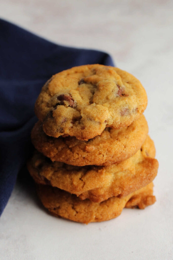 Stack of golden brown chocolate chip cookies ready to eat.
