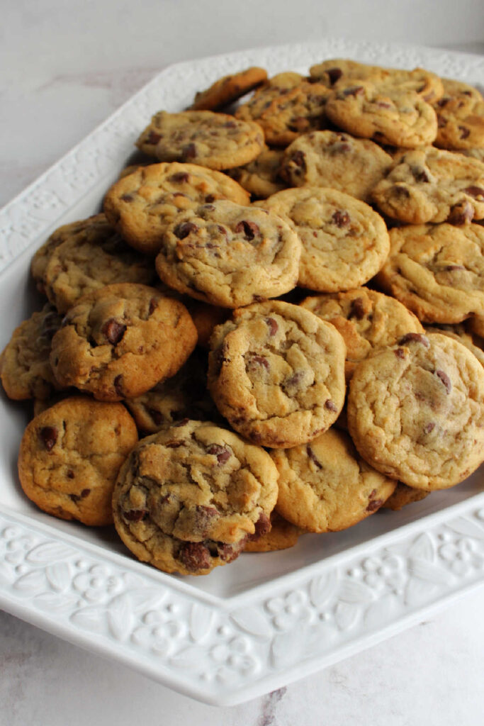 platter filled with chocolate chip cookies.