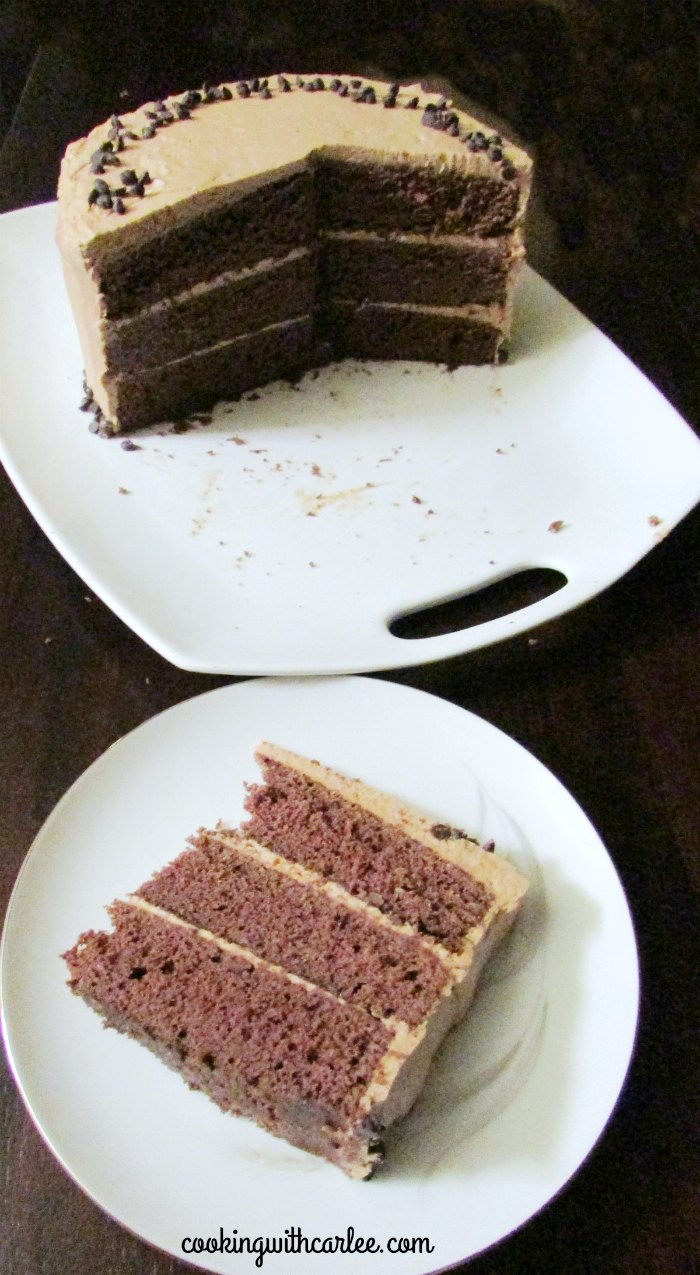 slice of cake served with remaining cake on platter in background
