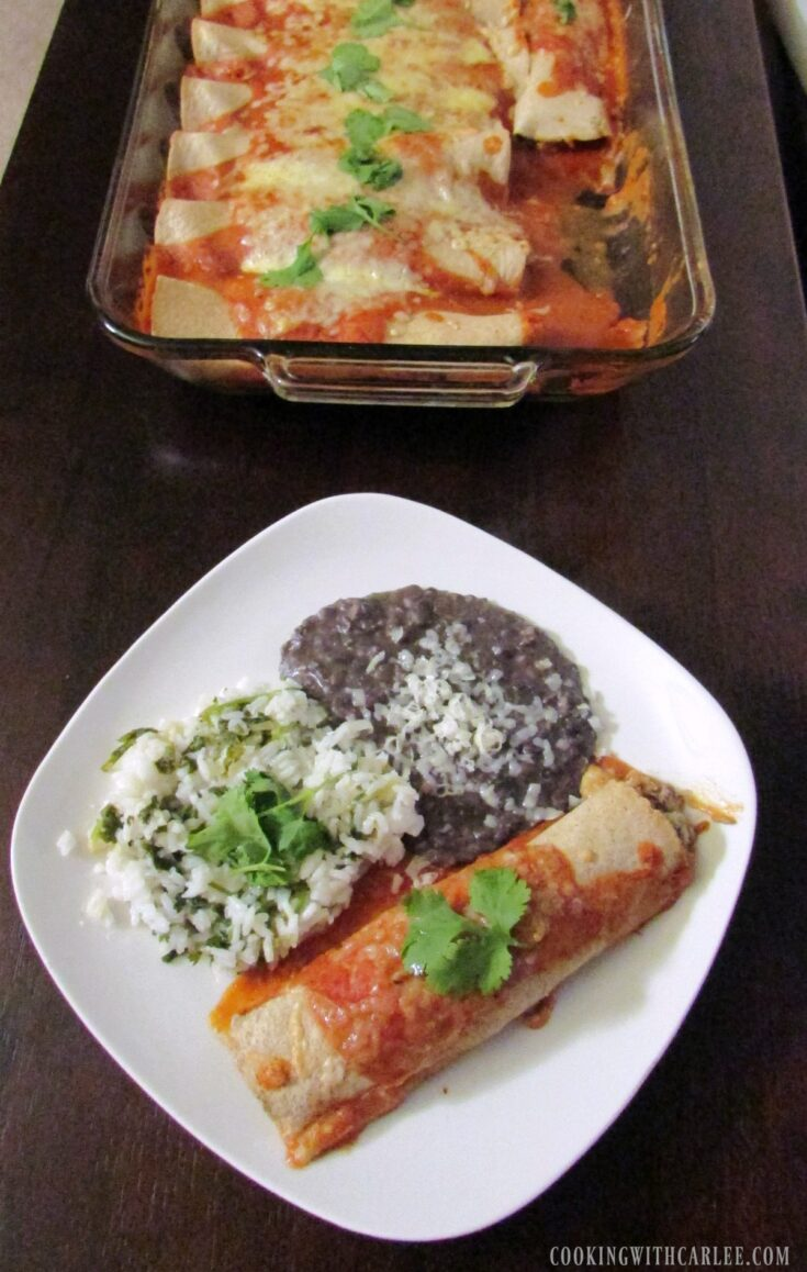 enchilada dinner in front of pan of remaining panful.