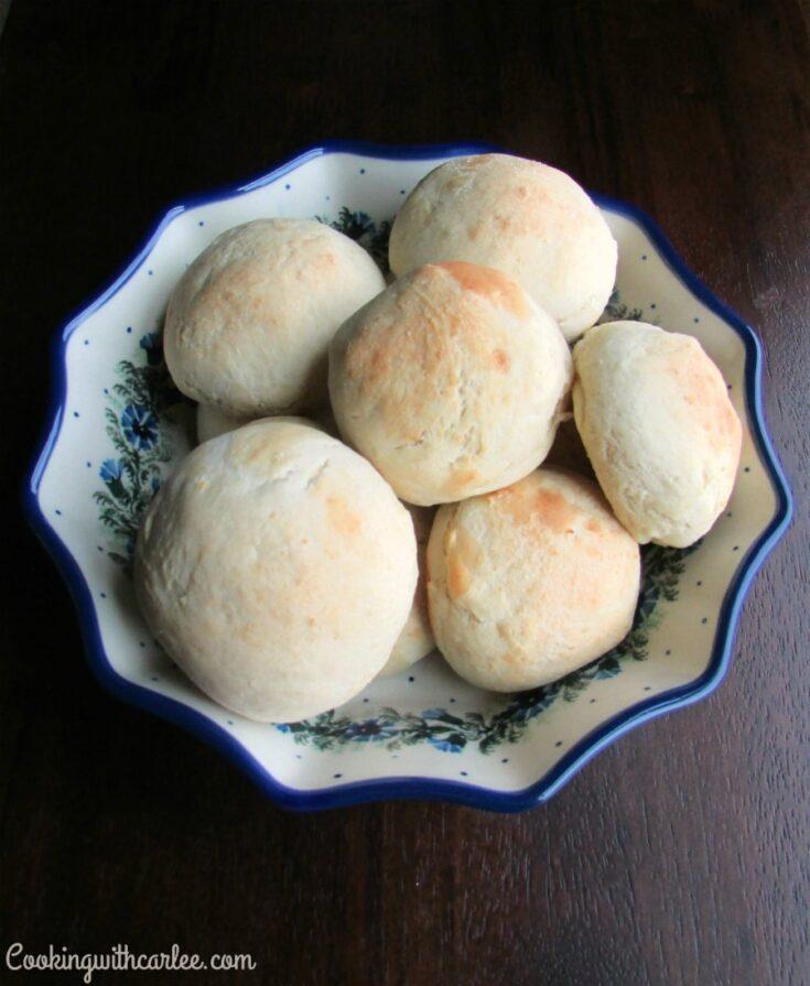 bowl of golden buttery potato rolls.