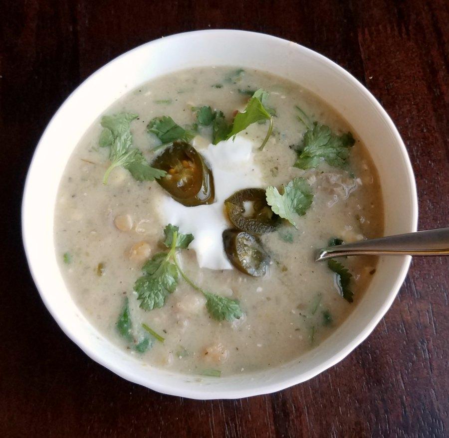white bowl filled with pork enchilada verde soup.