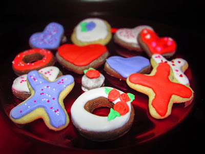 Plate of vanilla and chocolate sour cream cookies cut into Valentine's shapes and decorated with royal icing.