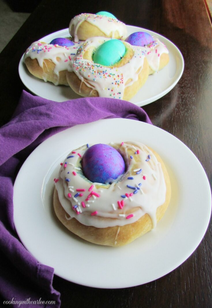 easter breads piled on platter with one on a small plate ready to eat.
