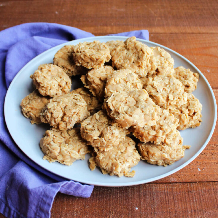 Serving plate loaded with no bake peanut butter cookies with oatmeal.