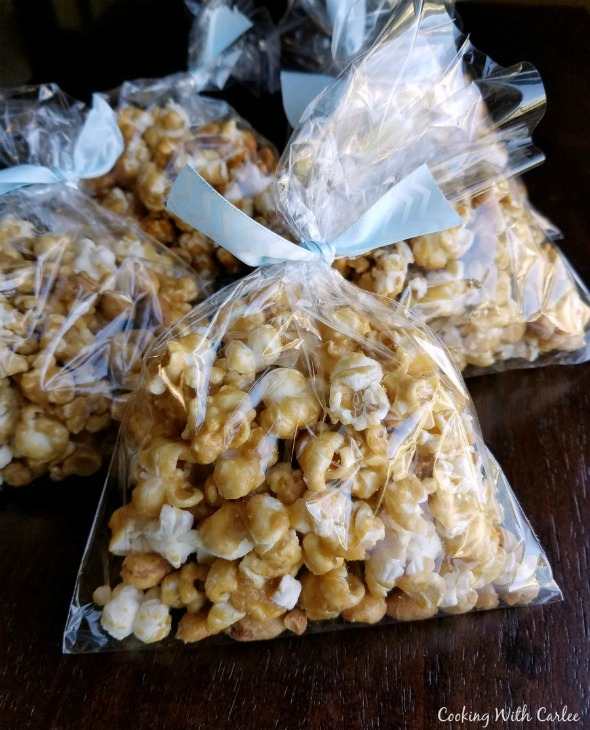 cellophane bags filled with caramel corn and tied with ribbon.