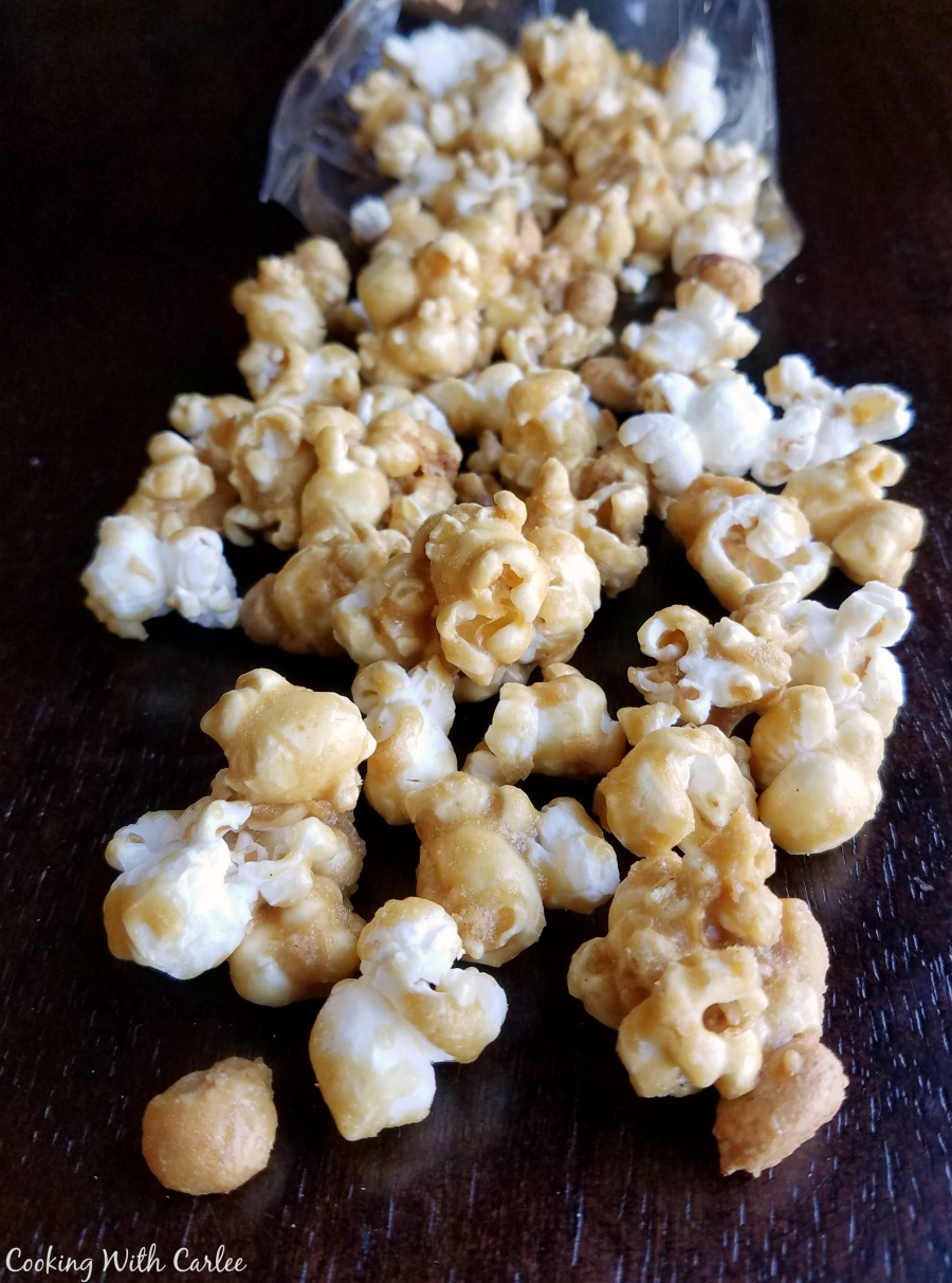 golden crunchy caramel coated popcorn and peanuts