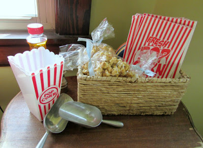 basket of caramel corn, scoops and popcorn bags.