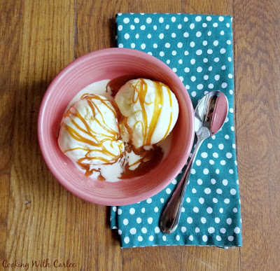 bowl of vanilla ice cream with homemade vanilla cajeta drizzled over the top