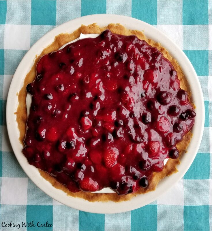 whole pie covered with berry sauce.